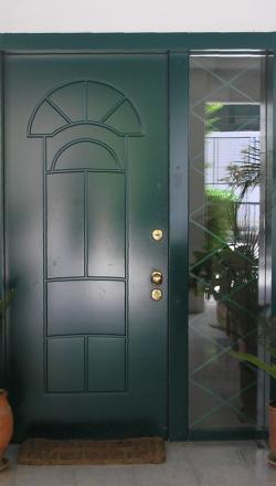 Πόρτα ασφαλείας με μεταλλικο σταθερο με επνδυση MDF RAL