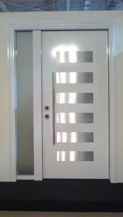 Πόρτα ασφαλείας με σταθερό και επένδυση αλουμινίου inox